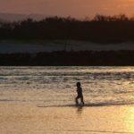 boy-running-through-water